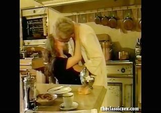 breasty retro playgirl sucks weenie in the kitchen